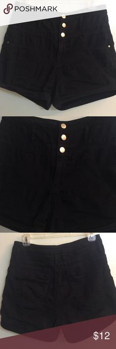 refuge Black Highwaisted Shorts These are super cute high waisted black shorts that are Orrin, Polyester and Spandex for a perfect and comfortable fit! They have 3 gold buttons and zipper in front. They are very lightly worn and look great. My granddaughter outgrew the after a very little use. refuge Shorts