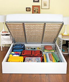 Hide and Go Sleep - Stashing goods under the bed is convenient, but not when you pull things out and they're covered in dust. The queen-size Apollo bed lifts up to reveal room for luggage and more. Hidden Shelf, Hidden Storage, Storage Shelves, Diy Storage, Underbed Storage Ideas, Storage Place, Storage Hacks, Bed Lifts, Lift Up Bed