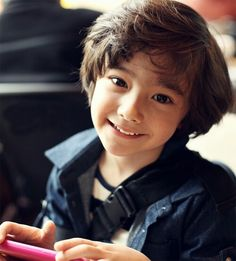 He looks part Asian? Cute