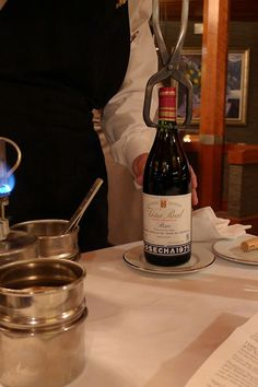 CVNE Viña Real Rioja Gran Reserva 1975. Carlos, the top notch sommelier, opened the bottle via port tongs, heated by the flame at left; then...
