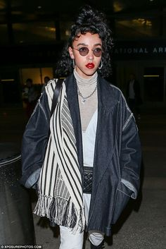 FKA Twigs and fiancé Robert Pattinson touch down at LAX #dailymail
