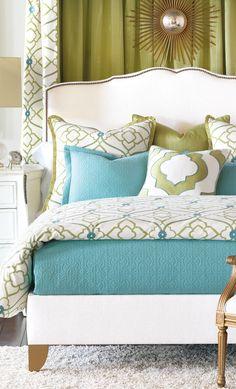 Modern green, blue, and white bedroom. Starburst accent. Shag rug.