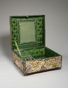 Casket. England 1670s. Medium: Satin worked with silk and metal thread, seed pearls; tent, satin, couching, Ceylon, detached needlepoint variations, knotted pile, knots, and crochet stitches; needle lace, metal bobbin lace; wood frame, silk lining, carved wooden feet. Dimensions: H. 8 x L. 16 x W. 14 1/2 inches (20.3 x 40.6 x 36.8 cm).