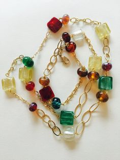 This colorful and 38 inches long necklace is sure to bring some fun into your summer wardrobe. It consists of lampworked glass beads, made by