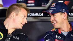 Own man: Kimi Raikkonen chats with Red Bull's Sebastian Vettel.