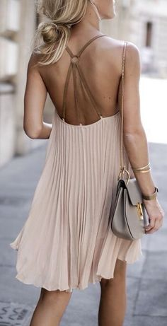 Blush colored dress with wonderful strap design in the back