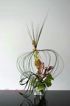 Modern flower arrangements - I am beginning to like modern more and more as a special touch in a traditional wedding.