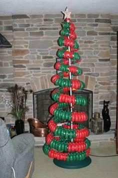Joel Ekey CBA Description: Spiral tree using & Chilli pepper lights around center pole on rotating base. All Things Christmas, Winter Christmas, Christmas Tree, Balloon Decorations, Christmas Decorations, Holiday Decor, Holiday Ideas, Balloon Tree, Spiral Tree
