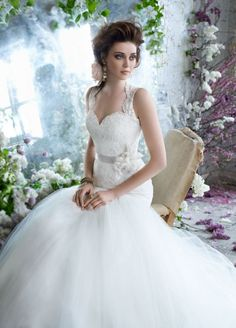 Ivory Alencon lace bridal ball gown, elongated bodice with keyhole back, floral belt at natural waist, full tulle skirt and sweep t