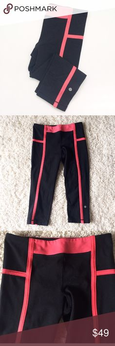 """Lululemon Black pink fitted Capri Pants Same fabric as the wunder unders, Luon nylon, polyester and Lycra. Breathable and comfortable. Great condition. Tag is gone, size 8. Waist 14"""" inseam 20"""". Hidden pocket on front on leg at bottom. lululemon athletica Pants Capris"""