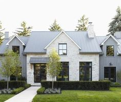 Clean lines, black steel windows, gray siding on sides, tiered facade.  We don't want stone though.