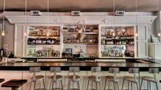 Modern Bar, With Edison bulb drop lighting. Love the simplicity and bar chairs