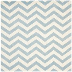 @Overstock - A contemporary chevron design and dense, thick pile highlight this handmade rug inspired by Moroccan patterns with today's updated colors. This floor rug has a blue background and displays stunning panel colors of ivory.http://www.overstock.com/Home-Garden/Handmade-Chevron-Blue-Ivory-Wool-Rug-7-Square/7347585/product.html?CID=214117 $284.99