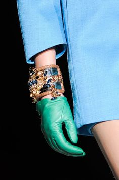 Dsquared² Fall 2014 - precious bracelets and green leather gloves with blue dress