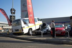 The scene where a taxi crashed and landed on another vehicle at the Fury Hyde Park car dealership in Johannesburg. Hyde Park, Journalism, Taxi, Scene, Vehicle, Journaling, Vehicles, Stage