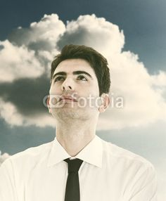 Vintage Portrait of Young Businessman with clouds on background