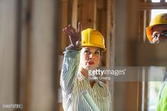 Stock Photo : Mature workers talking at construction site