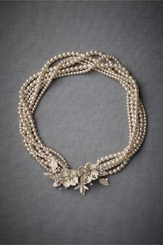 break of day from BHLDN. Would make good use of my grandmother's brooch? Maybe try dying pearls, too?