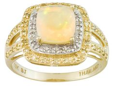 .76ct Ethiopian Opal With .18ctw Canary Diamond And .04ctw White Diamond Accent 10k Gold Ring