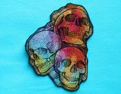 Hey, I found this really awesome Etsy listing at https://www.etsy.com/listing/235274131/rainbow-skull-trio-iron-on-patch-day-of