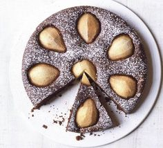 Flourless chocolate & pear cake. A light, but luscious cake made with hazelnuts - serve a slice for dessert with a dollop of crème fraîche