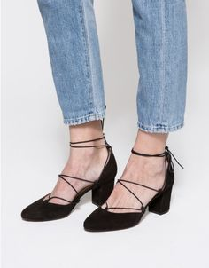 From Intentionally Blank, a classic suede wrap around heel in Black. Features round toe, matching wraparound lace up, leather uppers, leather lining, leather heel and synthetic outsole.  •Suede wrap around heel in Black •Round toe •Matching wraparo
