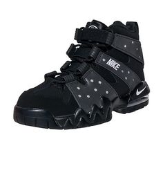 NIKE Charles Barkley style High top sneaker Perforated toe box and sides Lace and elastic closure Max Air unit in heel for performance Leather upper Rubber outsole Heel pull tab  Contrasting colors