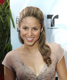 Pin for Later: Shakira's Hair Evolution From Redheaded Rebel to Caramel-Blond Mom April 2006 Shakira wore her hair much straighter (and look how shiny it is!) to the 2006 Billboard Latin Music Conference.