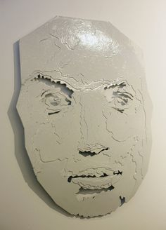A chipboard Sculpture by Bokang Mankoe based on the idea of Perfection and how that your profile changes when you fit your face in the Golden Ratio mask and that man perfect man becomes an Alter-ego.