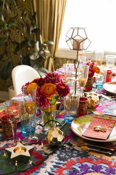 """The designer mixed in new pieces with vintage and heirloom accents, which infuse the table with a personal story. """"The rose-colored wine glasses were hand-me-downs from my grandmother,"""" she says. """"They have celebrated so many occasions with my family and me."""""""