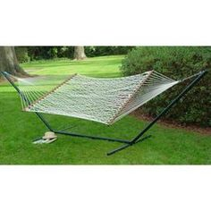 Turn your outdoors into a relaxing oasis with this Rope Hammock. Made of cotton, this hammock can withstand the elements and it has a hardwood frame. Hang this traditional hammock on your patio or between 2 trees in your garden using the included hanging hardware. You can also attach it to a hammock stand, which is sold separately. This portable camping hammock has a maximum weight capacity of 450 lbs. and can seat 2 people.