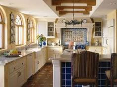 spanish style kitchens | love the cans on the lights | spanish