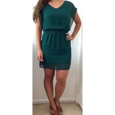 Green dress Green dress with sheer outer layer. Lined. Worn a few times, but in great condition. One pulled thread on the front of dress as shown in picture-reflected in price. Lush Dresses Mini