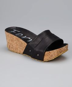 Step lively in this elegant sandal. Lifted by a cork wedge and shaped from supple faux leather, this slide combines timeless style with trend-right touches.2.75'' heel with 1.25'' platformMan-madeImported
