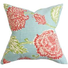Transform your home from serious to fun with this charming decor piece. This throw pillow features a floral detail in shades of red, white and green on an aqua blue fabric. This styling accessory comp