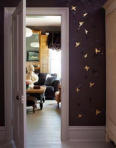Every wall in Lizzie Carney's house is painted this dark grey...every wall!! Just stunning