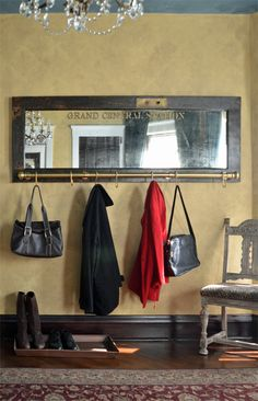 This unique wall mounted coat rack with mirror is made from an old door, mirror, and portions of an old bed frame. Add function and character to your home!