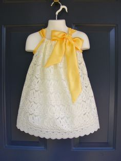 Custom Made Pillowcase Dress-0-8 years old-Fancy Eyelet in Ivory with Satin Bow-Can be made in Any Color Satin Bow. $25.00, via Etsy.