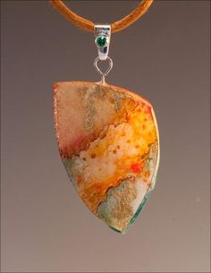 Laminated watercolor paper necklace by Mary Ferrulli Barker.