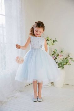 How adorable is this blue flower girls dress? We are in love with it! Check it out at www.foothillsbridal.com #blueflowergirldress #flowergirldress #lightblueflowergirldress #tulleflowergirldress #lightblueeasterdress