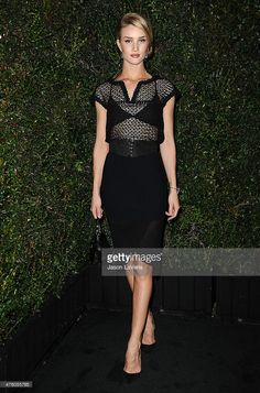Rosie Huntington-Whiteley attends the Chanel and Charles Finch pre-Oscar dinner at Madeo Restaurant on March 1, 2014 in Los Angeles, California.