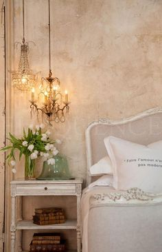 I'd never think to put 2 small, unmatching chandeliers above a nightstand but oh how precious it is!