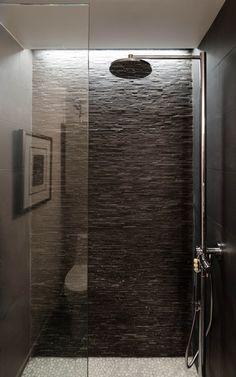 Beautiful indirect light, stackstone, open shower, shower head
