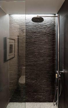 Beautiful indirect light, stackstone, open shower, shower head