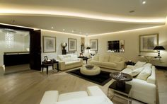 Converting Your Old Basement into Cool Basement Rooms: Surprising Basement Apartment Decorating Furniture Accessories Design Ideas Contemporary Interior Living Room Comfortable White Sofa Sets Round Table On Black Rug Laminated Flooring ~ workdon.com Interior Design Inspiration