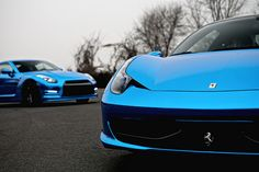 #Ferrari #458 #Italia in the foreground with a #Nissan #GTR in the background.  Why aren't all cars in the world painted this blue?