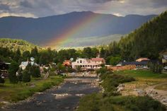 A beautiful rainbow over The Springs Resort bath house!  Photo by Incredible Pagosa Vacation Rentals