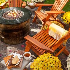 This gas fire column provides warmth and real flames at the center of a patio seating area. The stone-look design looks great on patios made of bricks or pavers, and you can use the open flames to toast marshmallows for s'mores
