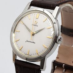 Vintage '60s OMEGA ref.14759 stainless steel watch with gilt markers and spear hands on a white dial. Runs on a Cal600 movement.