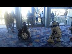 Remote control R2-D2 brings great joy to a boy in a wheelchair at the Star Wars Celebration Convention. | Real Funny